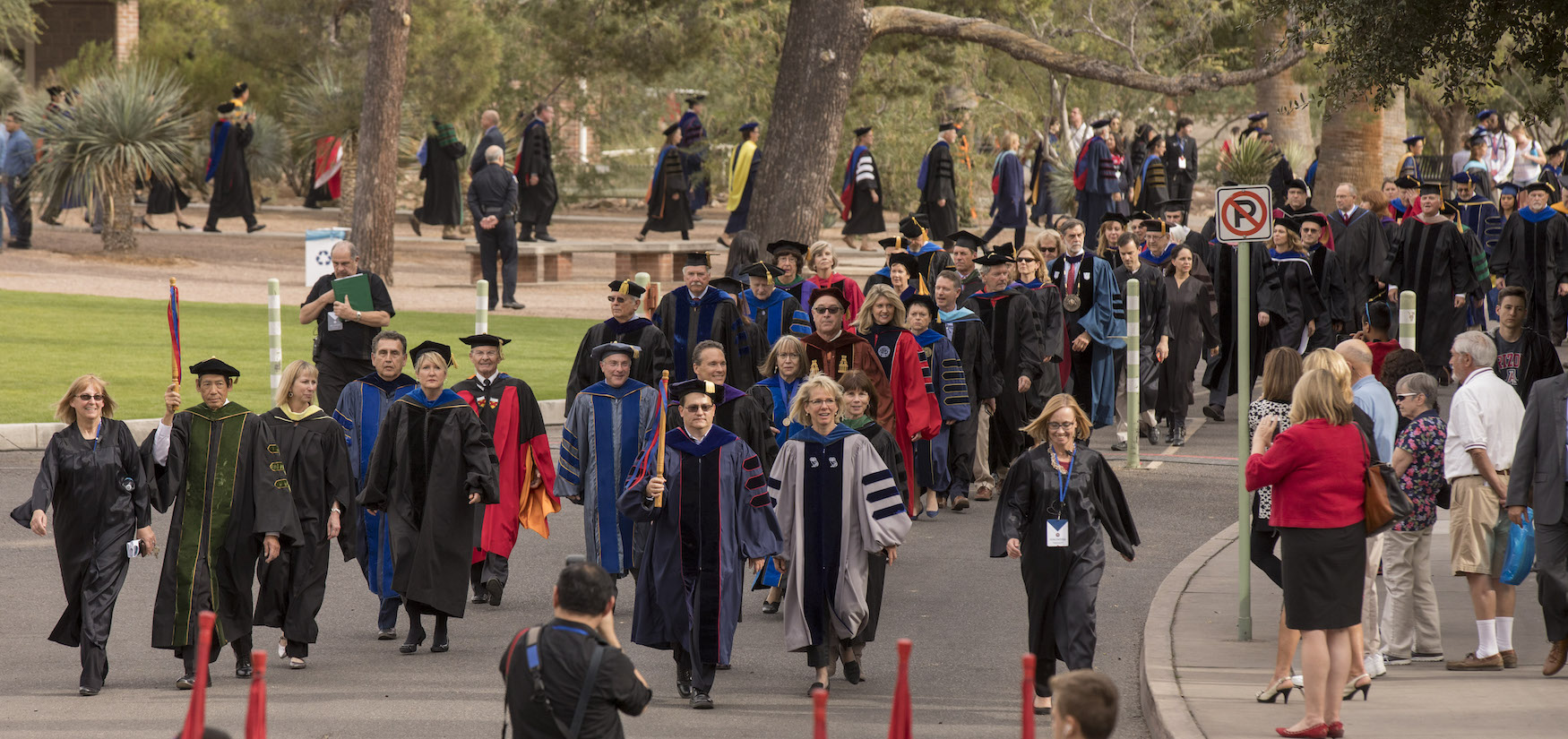 The formal procession heads from Old Main