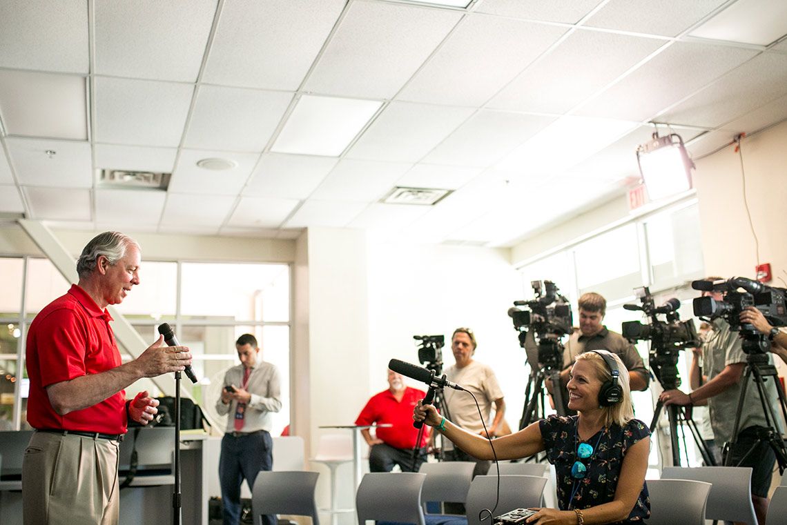 President Robbins talks with the media