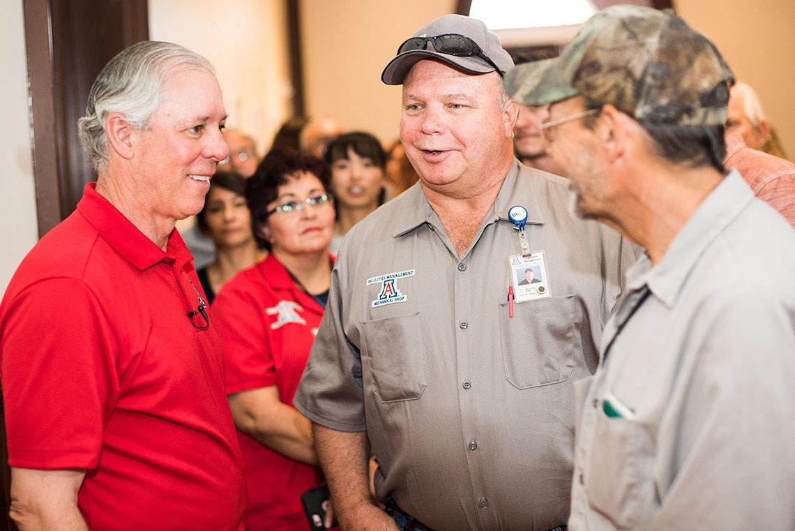 President Robbins talks with UA staff