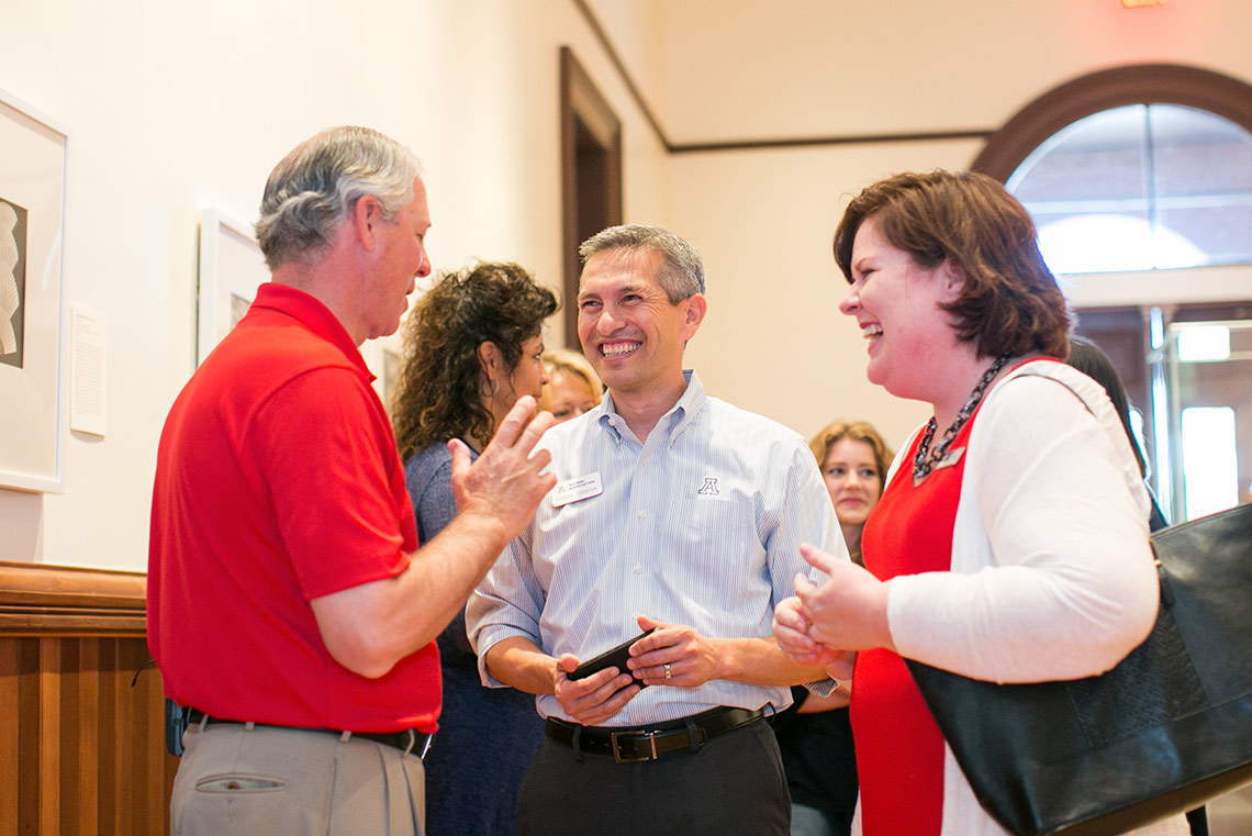 President Robbins enjoys conversation with people at Old Main