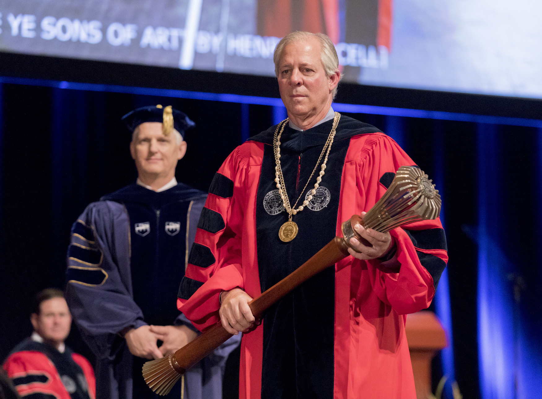 Dr. Robbins holding the Ceremonial Mace