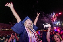 Katie Alhadeff, a business management graduate, celebrates at the close of the Commencement ceremony. (Photo: John de Dios/UA News)