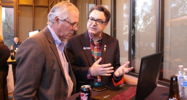 UA President Robert C. Robbins (left) talks with professor Moe Momayez about the mining sensor network Momayez developed and is bringing to market via the startup Guia. (Photo: Paul Tumarkin/Tech Launch Arizona)
